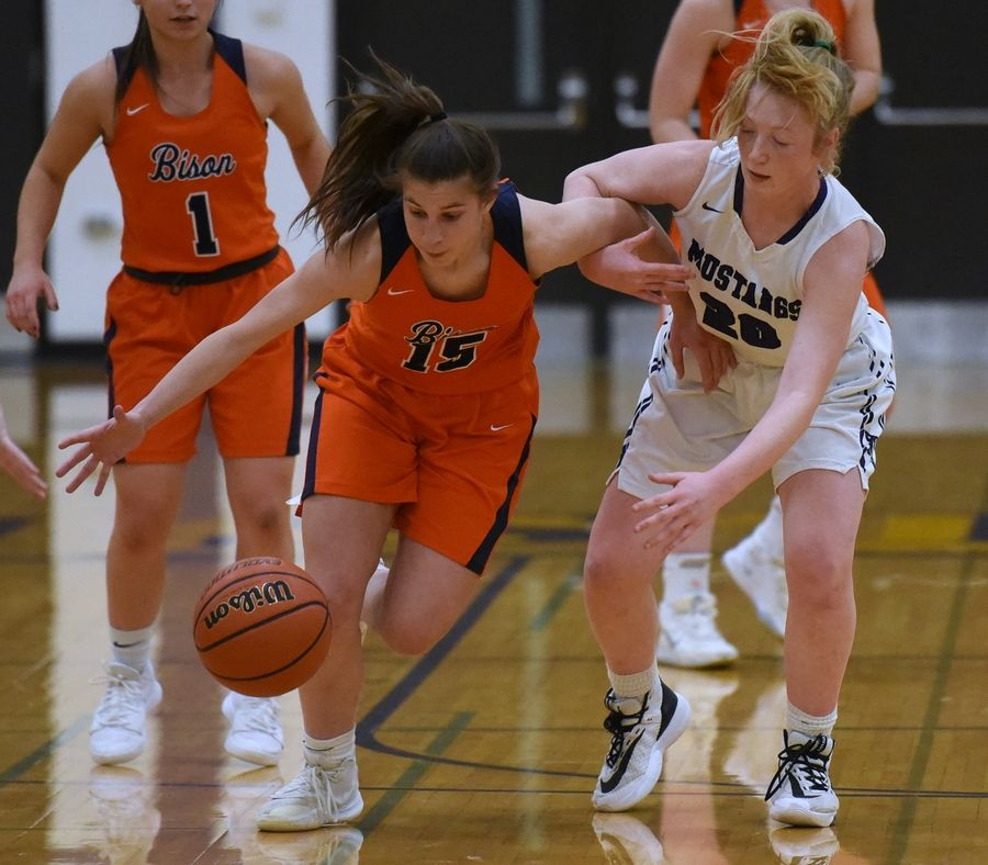 Buffalo Grove's Kora Kipley (15) and Rolling Meadows' Susannah Holifield (20) chase down a loose ball during Tuesday's girls basketball game in Rolling Meadows.
