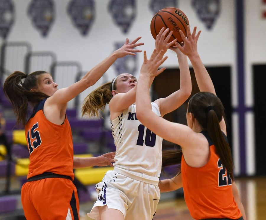 Buffalo Grove's Kora Kipley (15) and Kendra Lee (22) pressure Rolling Meadow's Madi Niedbala (10) during Tuesday's girls basketball game in Rolling Meadows.
