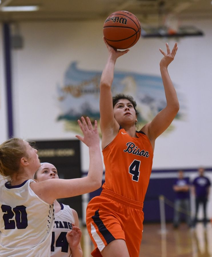 Buffalo Grove's Macy Floro (4) goes up for a shot during Tuesday's girls basketball game in Rolling Meadows.