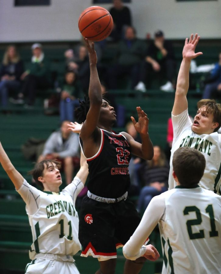 Timothy Christian's Matt Owens takes a shot against St. Edward in varsity boys basketball in Elgin Tuesday night.