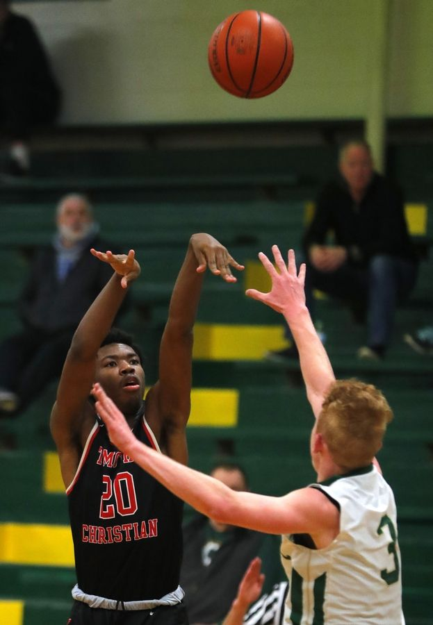 Timothy Christian's Josh Harris takes a shot against St. Edward in varsity boys basketball in Elgin Tuesday night.