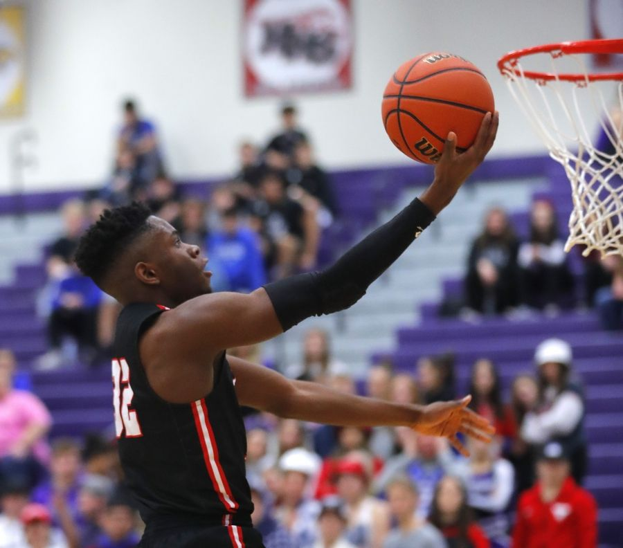 Uchenna Egekeze scored his 1,000th point in Huntley's win at Hampshire Wednesday night.