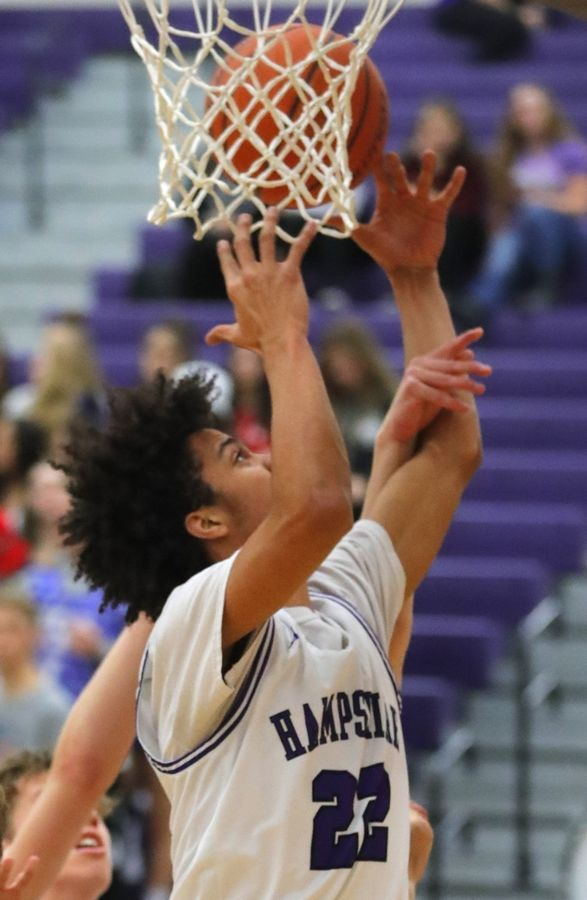 Hampshire's Keynan Davis grabs a rebound against Huntley in varsity boys basketball at Hampshire Wednesday night.