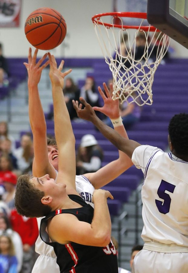 Huntley's Luke DiFrancesca reaches for a rebound in varsity boys basketball at Hampshire Wednesday night.