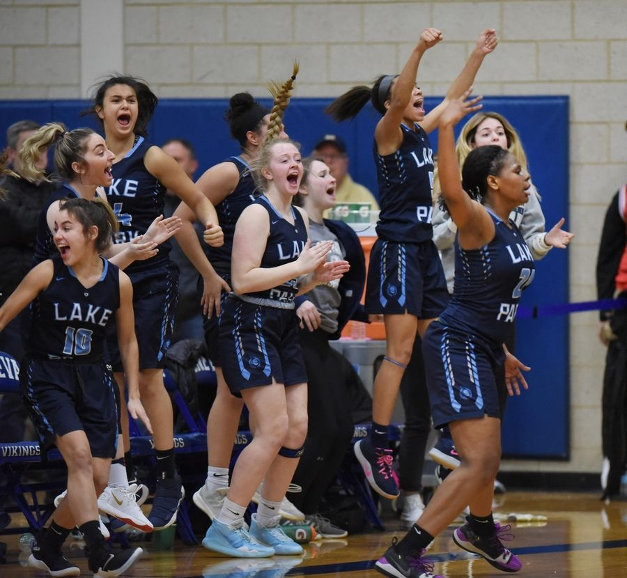 The Lake Park bench erupts as Darrione Rogers signals her three-point shot to tie the score with seconds left in regulation against Geneva in a basketball game in Geneva Friday. The Lancers won in overtime.