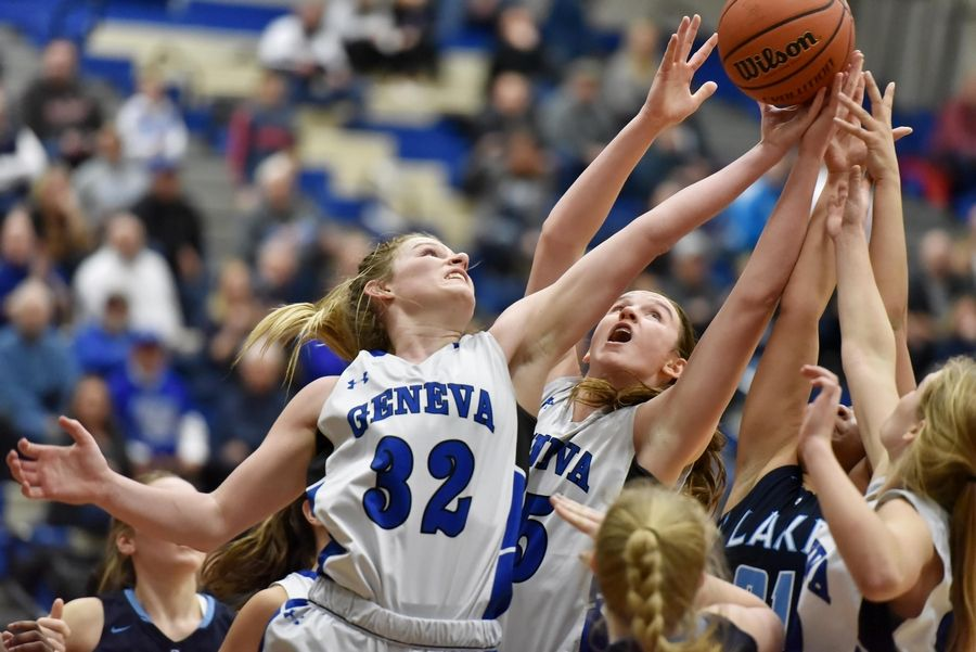 Geneva's Lindsay Blackmore stitches for a rebound with teammate Cassidy Arni against Lake Park's Darrione Rogers in a basketball game in Geneva Friday.