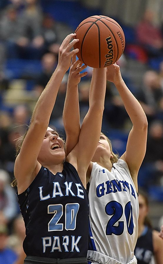 Lake Park's Emma Thorne and Geneva's Kelly McCloughan in a basketball game in Geneva Friday.