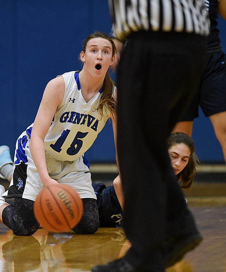 Geneva's Cassidy Arni reacts as she is called for fouling Lake Park's Sara Balli in a basketball game in Geneva Friday.