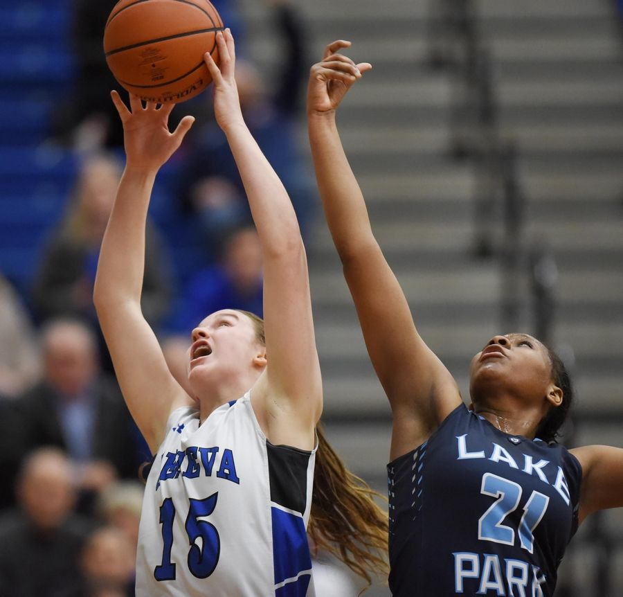 Geneva's Cassidy Arni and Lake Park's Darrione Rogers reach for a rebound in a basketball game in Geneva Friday.