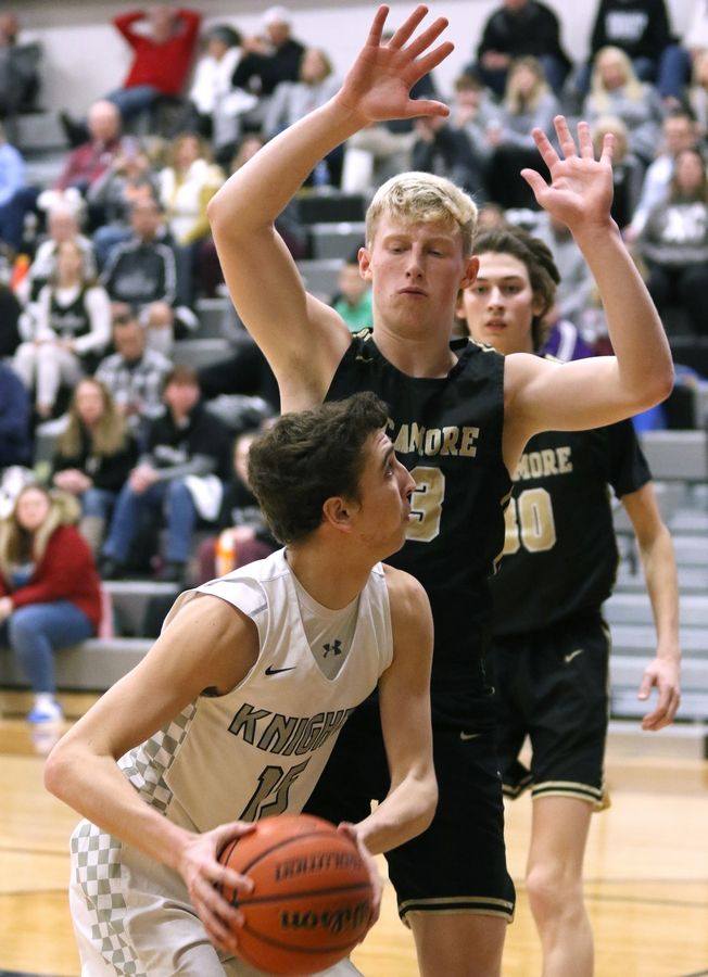 Sycamore senior Jackson Johnson holds his ground as Kaneland senior Will Cushman looks for his shot during their game Friday night at Kaneland High School in Maple Park.