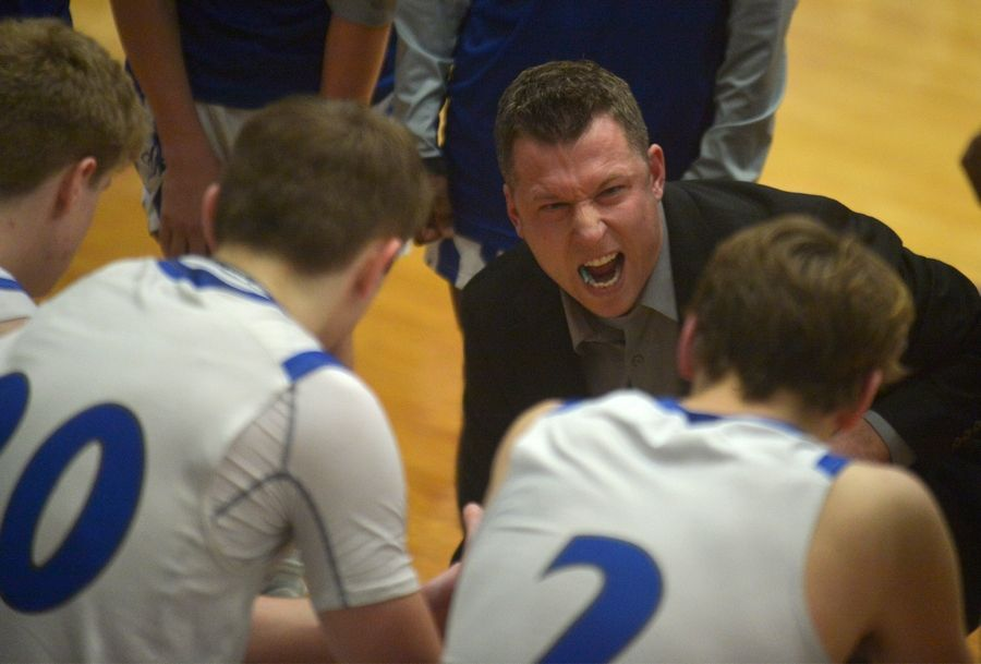 Burlington Central head coach Brett Porto gives direction to his team in the closing seconds of in the Rockets' 51-48 loss to DeKalb Saturday Jan 18 in the Burlington MLK Tournament.