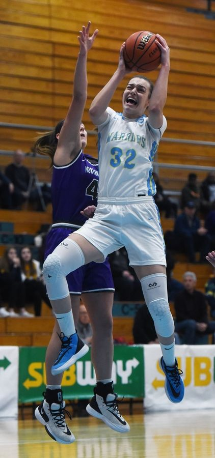 Maine West's Angela Dugalic drives to the basket against Northwestern High School's (IN.) Kendall Bostic during Saturday's game at Willowbrook High School in Villa Park.
