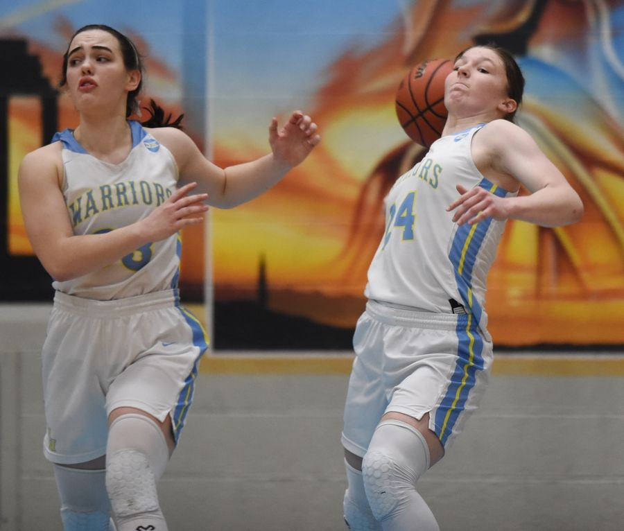 Maine West's Jaclyn Riedl tries to shoot a desperation shot as teammate Dylan Van Fleet runs beside her Northwestern High School's (IN.) during Saturday's 61-58 loss to Northwestern High School (IN.) at Willowbrook High School in Villa Park.