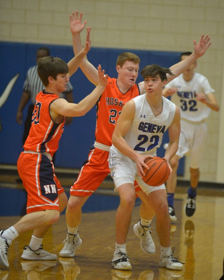 Naperville North's Michael Imhoff, left, and Myles Barry trap Geneva guard Mason Mascari in the first quarter Monday Jan 20 in the Geneva MLK Day of Hoops.