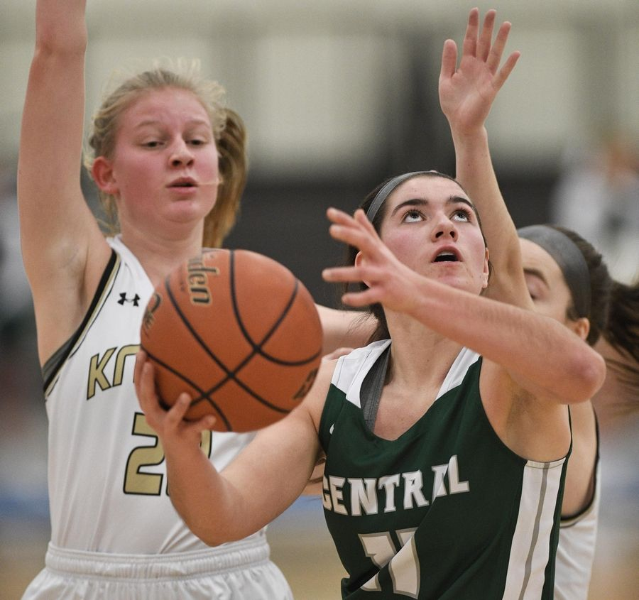 Grayslake Central's Madeline Mussay gets between Grayslake North's Grayslake North Eden Hartigan and Meghan Delahunty to score in a girls basketball game at Central High School Wednesday.