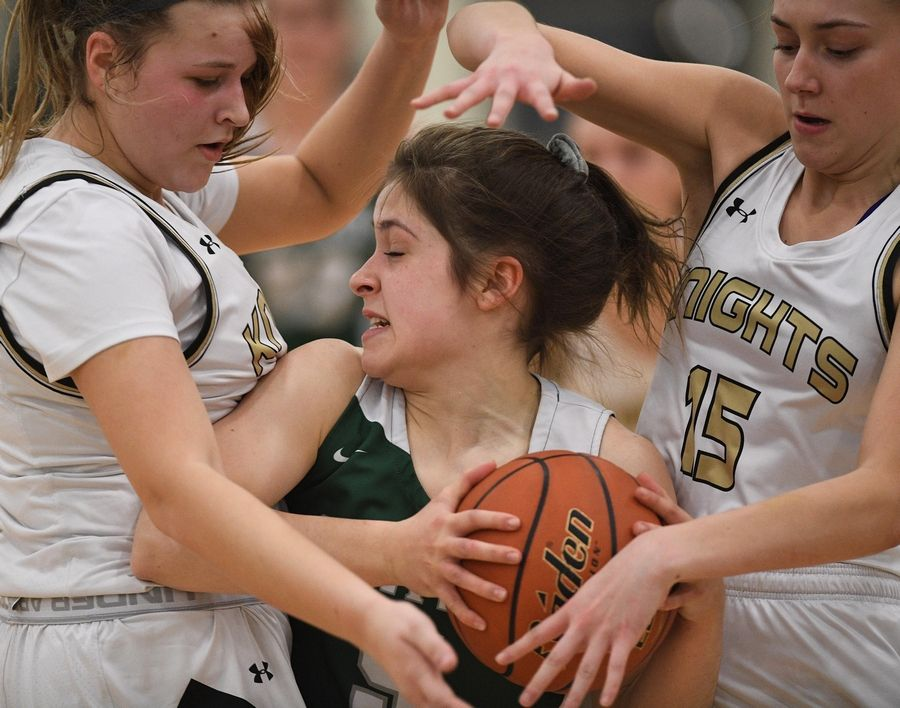 Grayslake North's Peyton Gerdes and Grace Wamser, right, pressure Grayslake Central's Monica Schleg in a girls basketball game at Central High School Wednesday.