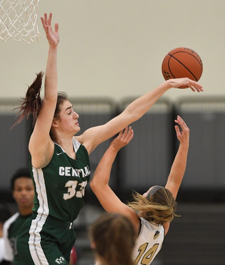 Grayslake Central's Kate Bullman blocks a shot by Grayslake North's Faith Standerski in a girls basketball game at Central High School Wednesday.