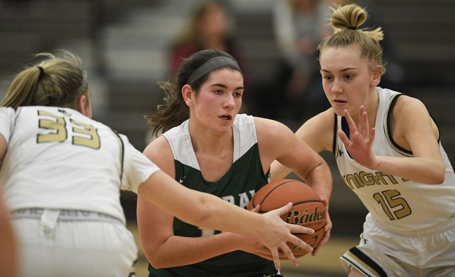 Grayslake Central's Madeline Mussay gets between Grayslake North's Peyton Gerdes and Grace Wamser in a girls basketball game at Central High School Wednesday.