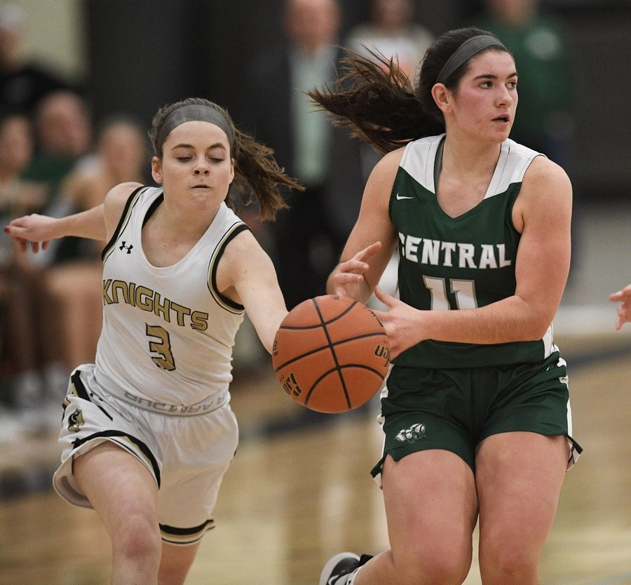 Grayslake North's Meghan Delahunty strips the ball from Grayslake Central's Madeline Mussay in a girls basketball game at Central High School Wednesday.
