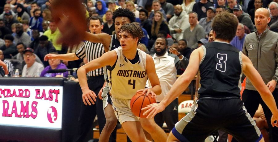 Rolling Meadows' Daniel Sobkowicz drives toward the basket against Fenwick during the When Sides Collide Shootout at Glenbard East on Saturday. The Mustangs lost 69-56.