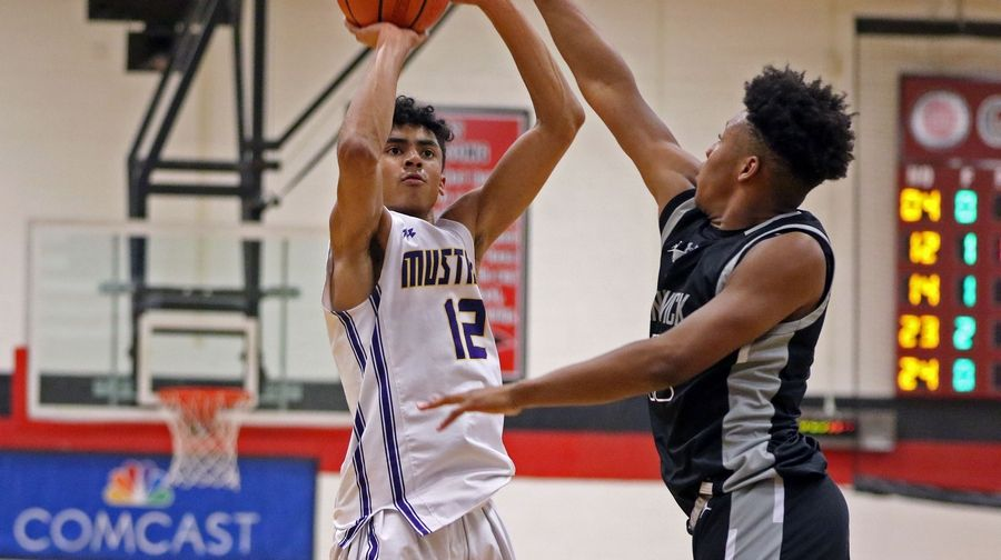 Rolling Meadows' Max Christie takes a shot against Fenwick during the When Sides Collide Shootout at Glenbard East on Jan 25. The Mustangs lost 69-56.