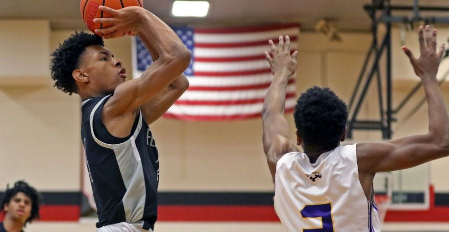 Fenwick's Eian Pugh takes a shot against Rolling Meadows during the When Sides Collide Shootout at Glenbard East on Jan 25. The Friars won 69-56.