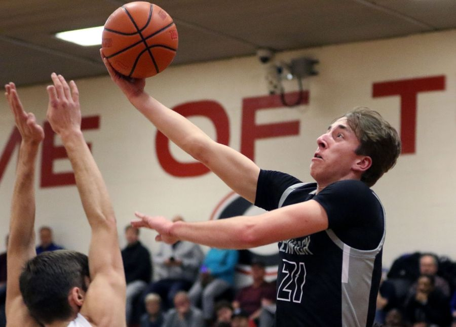 Fenwick's David Gieser goes up for a shot against Rolling Meadows during the When Sides Collide Shootout at Glenbard East on Jan 25. The Friars won 69-56.