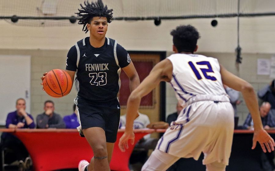 Fenwick's Bryce Hopkins brings the basketball up the court against Rolling Meadows during the When Sides Collide Shootout at Glenbard East on Jan 25. The Friars won 69-56.