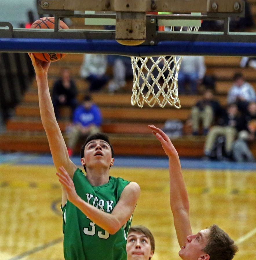 York's Nick Hesch scores two points against Lyons Township during a game in La Grange on Jan. 31. The Dukes won 42-32.