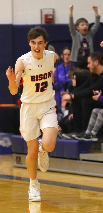 Buffalo Grove's Kam Craft signals after hitting a 3-pointer against Rolling Meadows in varsity boys basketball Friday. Craft had 46 points but the Bison fell in double overtime 93-83.