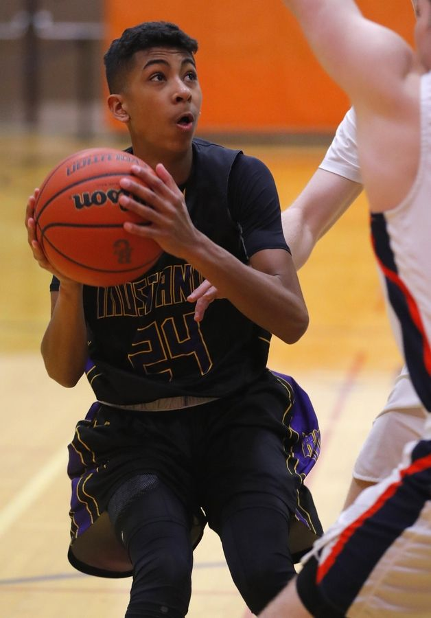 Rolling Meadows' Cameron Christie moves the ball against Buffalo Grove in varsity boys basketball Friday.