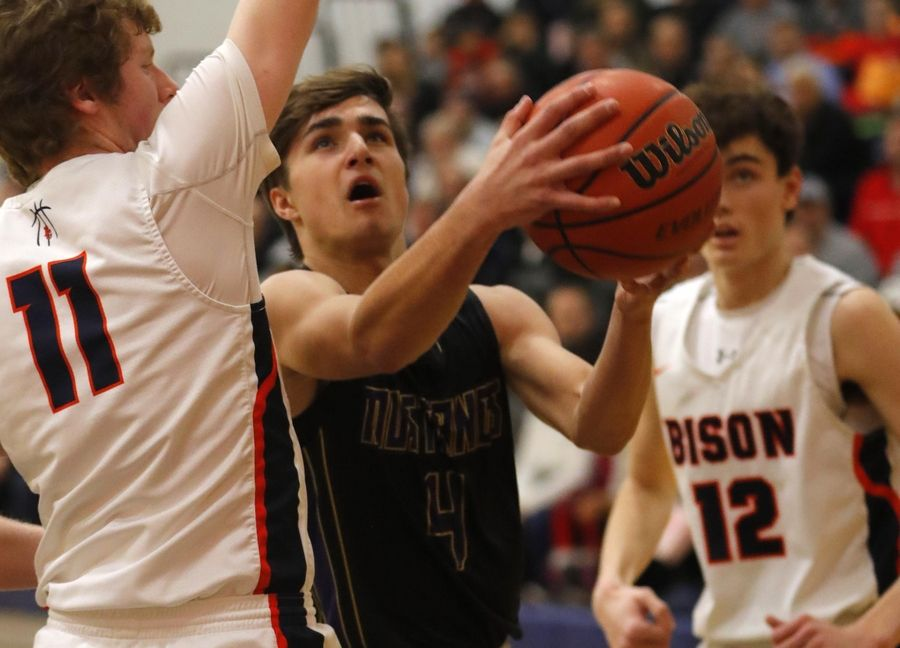 Rolling Meadows' Daniel Sobkowicz drives to the hoop at Buffalo Grove in varsity boys basketball Friday.