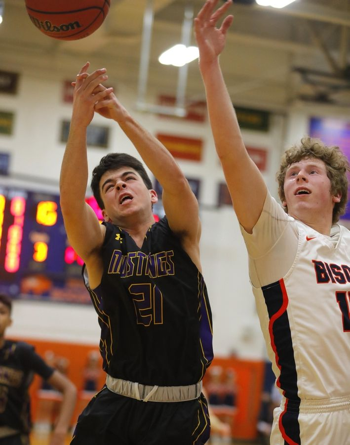 Rolling Meadows' Luke Duffer, left, and Buffalo Grove's Nate Cole scramble for a rebound in varsity boys basketball Friday.