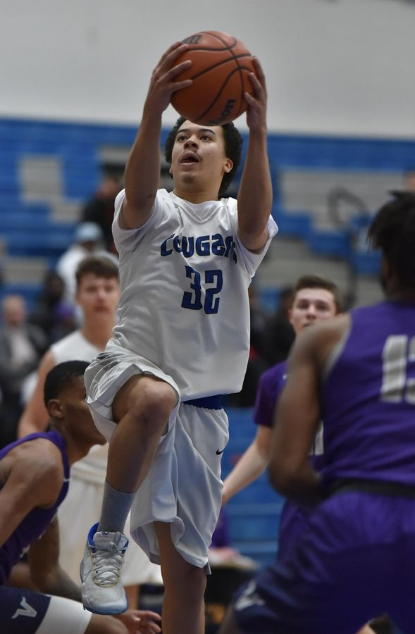 Vernon Hills' Quincy Paddock scores against Niles North in a boys basketball game in Vernon Hills Friday.