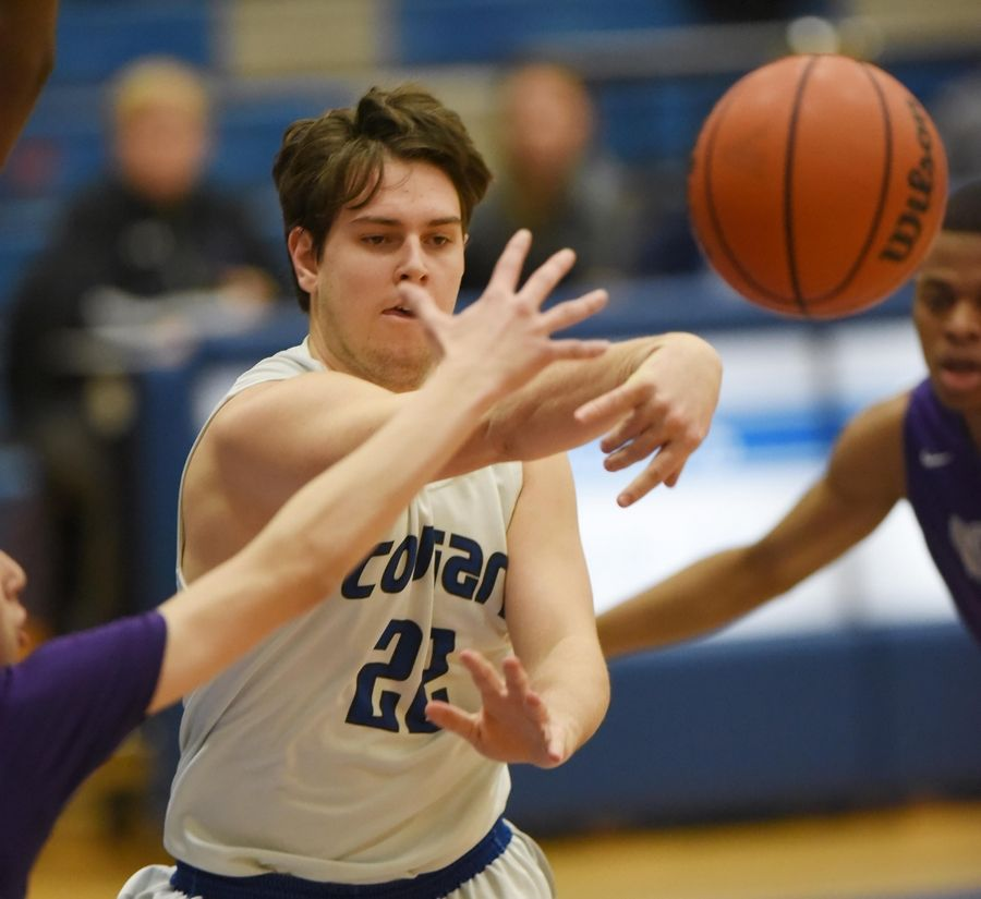 Vernon Hills' Nick Burrows passes against Niles North in a boys basketball game in Vernon Hills Friday.