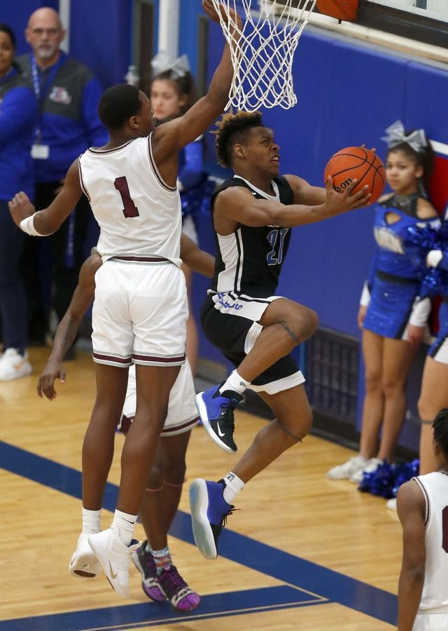 Elgin's Jeffery Lomax (1) tries to get to Larkin's Jashon Johnson-Neals (21) Friday during the crosstown game in Elgin.