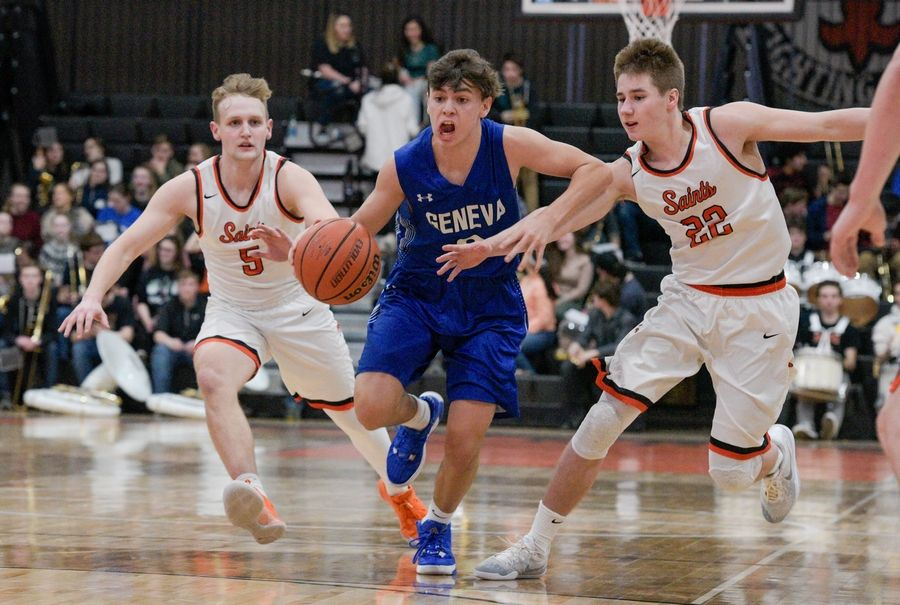 Geneva's Nathan Valentine (3) drives the ball down the court between St. Charles East's Luke Matheny (5) and St. Charles East's Zack Clodi (22) during varsity boys basketball in St. Charles Feb. 7.