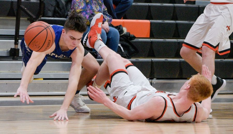 Geneva's Quin McNeive (0) and St. Charles East's Chase Monkemeyer (30) tumble to ground during varsity boys basketball in St. Charles Feb. 7.