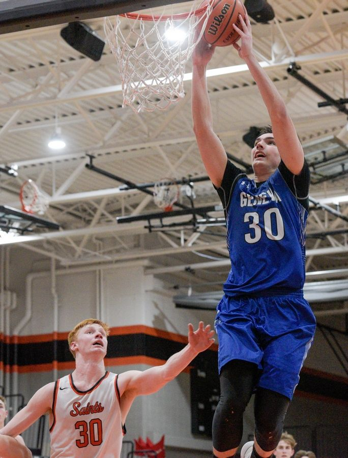 Geneva's Joshua Preston (30) dunks the ball during a 66-58 loss to St. Charles East in St. Charles Feb. 7.