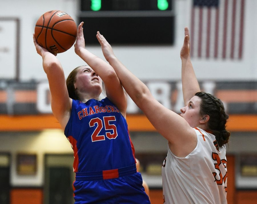 Dundee-Crown's Makayla Gotter (25) goes for a shot under pressure from Crystal Lake Central's Hailey Geske during Wednesday's girls basketball game in Crystal Lake.