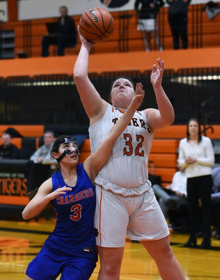 Crystal Lake Central's Hailey Geske (32) goes for a shot guarded by Dundee-Crown's Emily Oldham during Wednesday's girls basketball game in Crystal Lake.