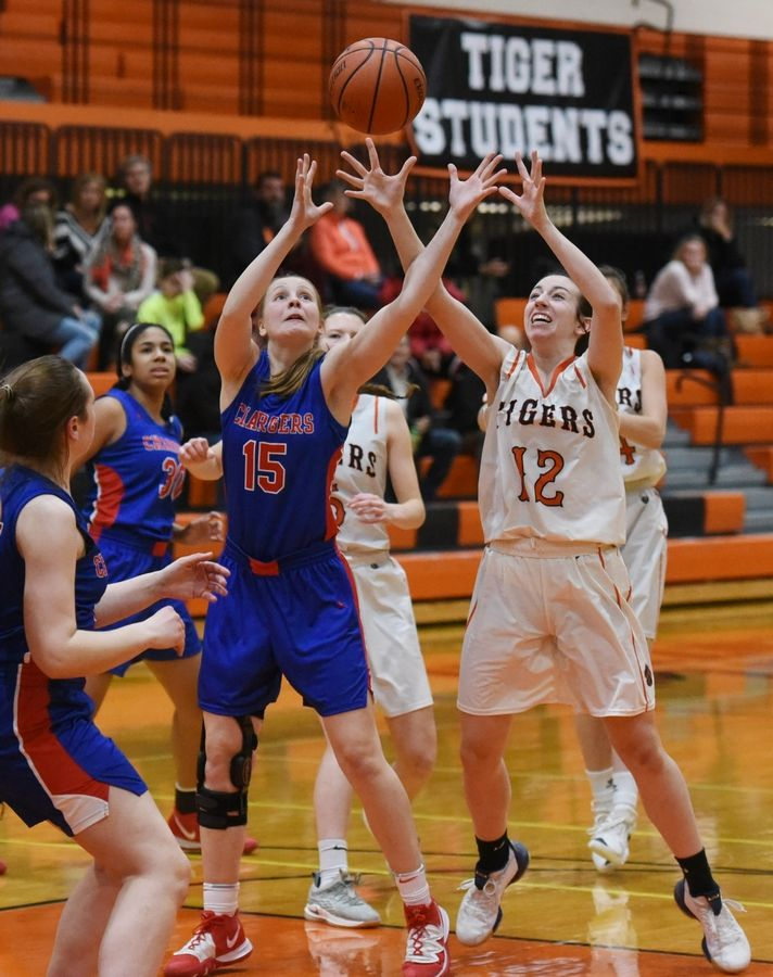 Dundee-Crown's Cassidy Randl (15) and Crystal Lake Central's Paige Keller (12) reach for a rebound during Wednesday's girls basketball game in Crystal Lake.