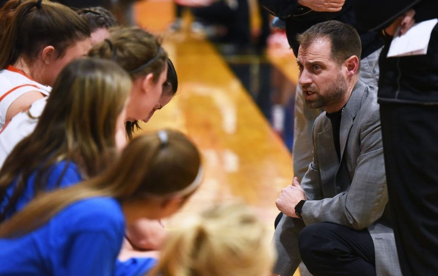 Crystal Lake Central head coach Derek Crabill talks to his players during Wednesday's girls basketball game against Dundee-Crown in Crystal Lake.