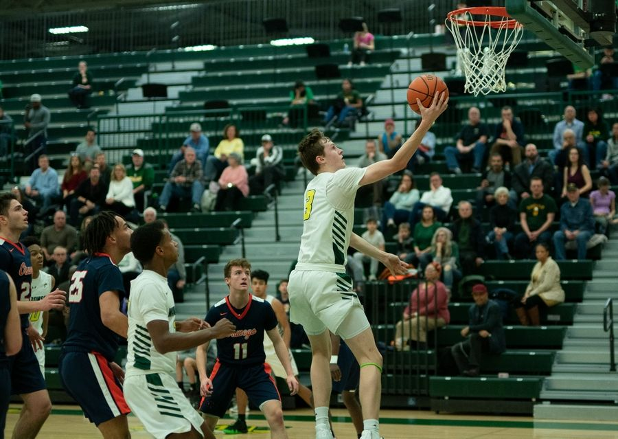 Waubonsie Valley's Ben Schwieger (3) drives to the basket against Oswego at Waubonsie Valley High School in Aurora, IL on Tuesday, February 04, 2020