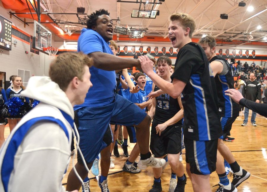 St. Charles North's Christian Czerniak celebrates with the Blue Fan Group after the North Stars beat crosstown rival St. Charles East in their first meeting in December. The rematch is Friday, and both teams are 9-1 playing for the DuKane Conference lead.