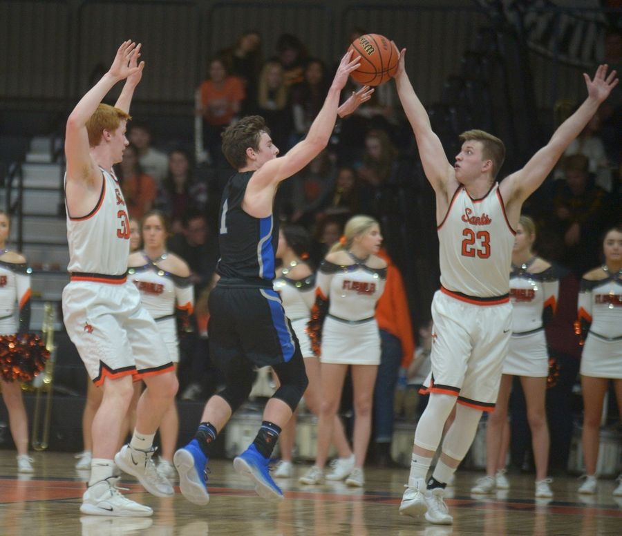 St. Charles East's Scott Breidigan deflects a pass by St. Charles North guard Luke Scheffers. The Saints' pressure defense will be a key factor Friday.
