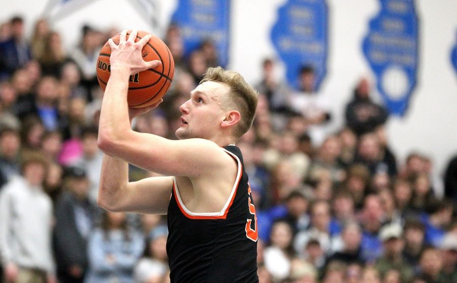 St. Charles East's Luke Matheny shoots the ball during a game at St. Charles North on Feb. 14.