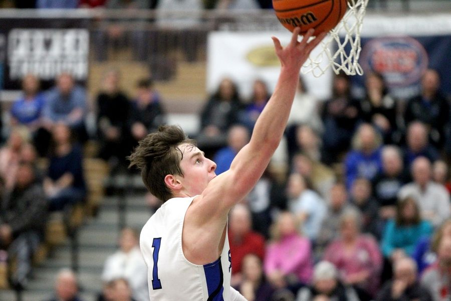St. Charles North's Luke Scheffers gets the ball up during a home game against St. Charles East Feb. 14.