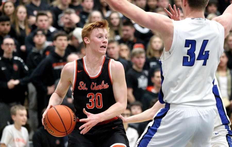 St. Charles East's Chase Monkemeyer (30) looks to pass the ball during a game at St. Charles North on Feb. 14.