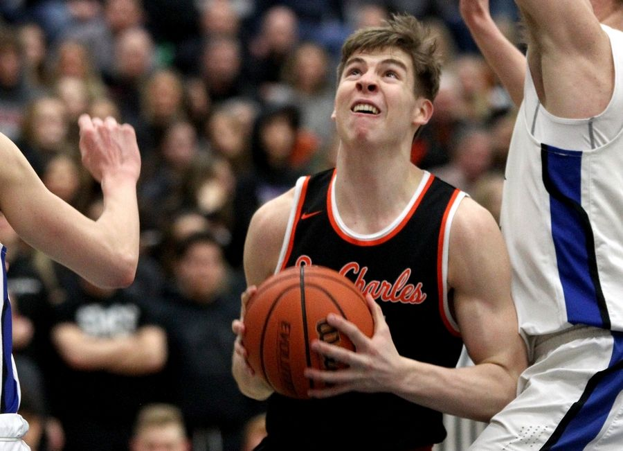 Aidan Sullivan of St. Charles East looks for an opening from under the basket during a game at St. Charles North on Feb. 14.